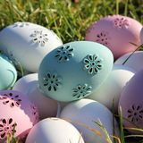 Easter eggs. Lot of Easter eggs pastel colors, white, pink, purple  and green in the garden a sunny day Royalty Free Stock Photography