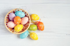 Easter eggs. Lying in a basket on table royalty free stock photo