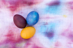 Easter eggs. Lying on a colorful dyed napkin Royalty Free Stock Photo