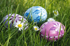 Easter eggs lying on the grass Stock Photo