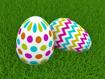 Easter eggs lying on green grass Stock Images