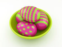 Easter eggs lying in green spring bowl Stock Photography
