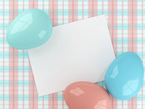 Easter eggs lying on plaid tablecloth with chit Stock Photography