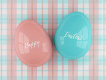 Easter eggs lying on plaid tablecloth with greetings Royalty Free Stock Photography