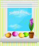 Easter eggs. Lying on the window sill at the window. Cute Easter card Royalty Free Stock Photography