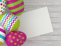 Easter eggs lying on wooden desk with chit Royalty Free Stock Photography