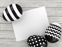 Easter eggs lying on wooden desk with paper chit Royalty Free Stock Photo