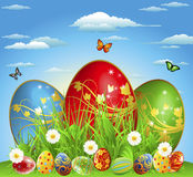 Easter eggs in the meadow with flowers Royalty Free Stock Photos