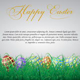 Easter eggs with mesh in grass on a white shining background. Wi Royalty Free Stock Image