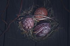 Easter eggs in a metal basket on a wooden table Stock Image