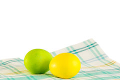 Easter eggs on a  napkin on a white background. Painted Easter eggs on a checkered napkin on a white background Royalty Free Stock Photo