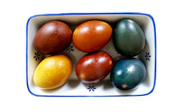 Naturally dyed Easter Eggs, Isolated. Easter eggs colored with natural dyes, overhead view isolated on white background Stock Photo