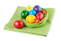 Easter Eggs in natural straw nest Stock Photos
