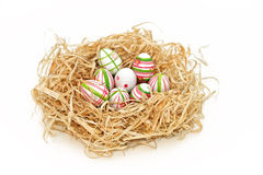 Easter eggs into a nest Royalty Free Stock Images