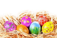Easter eggs in nest. Hand painted Easter Eggs in a raffia nest Stock Photo