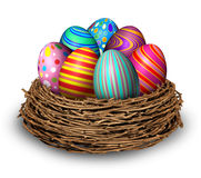 Easter Eggs Nest. Holiday symbol decoration with seven colored festive spring ovals in a bird nest for celebration of a religious and traditional cultural event Royalty Free Stock Photo