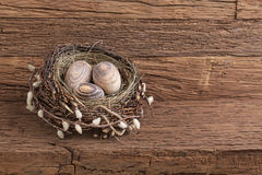 Easter eggs in nest. On wooden background royalty free stock photography