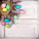 Easter eggs in nest on antique panel Stock Image