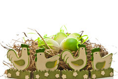 Easter eggs in nest and chickens Royalty Free Stock Photo