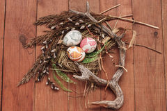 Easter eggs in the nest. Easter eggs in nest from dry grass Stock Images