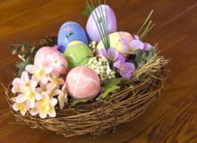 Easter eggs in nest with flowers Stock Images