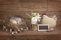 Easter eggs in nest and flowers Royalty Free Stock Photos