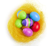 Easter eggs in the nest. Hand coloured easter eggs in the yellow nest Stock Photos