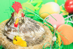 Easter eggs and nest with a hen and chickens Royalty Free Stock Photo
