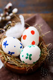 Easter eggs in a nest on napkin Royalty Free Stock Images