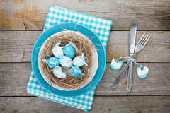 Easter eggs nest on plate Stock Image