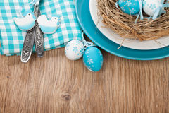 Easter eggs nest on plate Stock Images