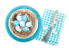 Easter eggs nest on plate with silverware Royalty Free Stock Photo
