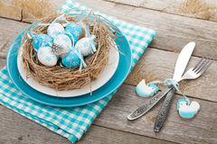 Easter eggs nest on plate with silverware Royalty Free Stock Photography