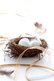 Easter eggs in a nest with ribbons and feathers Royalty Free Stock Photography