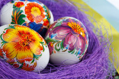 Easter eggs in the nest with ribbons Royalty Free Stock Photo