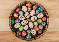 Easter eggs in the nest. On rustic wooden background Stock Image