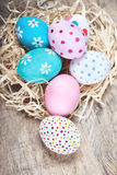 Easter eggs in nest on rustic wooden planks with copyspace. Happ Royalty Free Stock Image