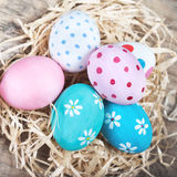Easter eggs in nest on rustic wooden planks with copyspace. Happ Royalty Free Stock Photography