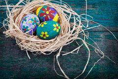 Easter eggs in nest on rustic wooden planks Royalty Free Stock Image