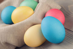 Easter eggs in nest from sack textile rustic style Royalty Free Stock Image
