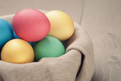Easter eggs in nest from sack textile rustic style Royalty Free Stock Images