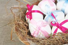 Easter Eggs in Nest Tied with Ribbon Stock Photo