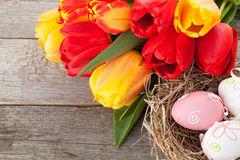 Easter eggs in nest and tulip flowers Royalty Free Stock Photography