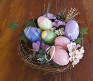 Easter eggs in nest with vegetation Royalty Free Stock Image