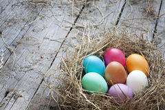 Easter eggs in nest on vintage wooden boards Stock Image