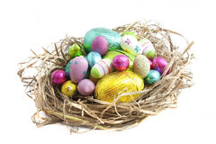 Easter eggs in nest on white Stock Photos