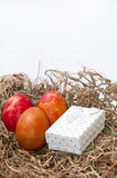 Easter eggs in the nest and white box Royalty Free Stock Image