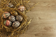 Easter eggs in nest on wooden background Royalty Free Stock Image
