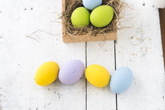 Easter eggs in the nest on wooden background Royalty Free Stock Photos