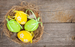 Easter eggs nest on wooden background Stock Photography